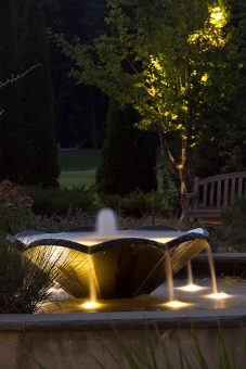 Outdoor landscaping lighting systems need periodic inspection and sometimes repair. Our landscape contractors will change burned out bulbs repair broken fixtures cut wires or any other disruptions to your landscape - Landscaping Maintenance Company Near Me Water Feature IMG